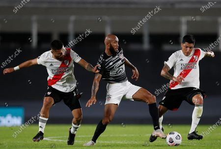 Stock Image of Fredy Hinestroza of Colombia's Junior, center, battle for the ball with Paulo Diaz, left, and Enzo Perez of Argentina's River Plate during a Copa Libertadores soccer match in Buenos Aires, Argentina