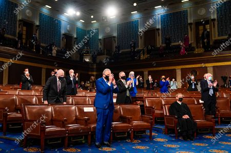 Senate Majority Leader Charles E. Schumer (D-N.Y.) applauds as President Joe Biden addresses a joint session of Congress, with Vice President Kamala Harris and House Speaker Nancy Pelosi (D-Calif.) on the dais behind him in the House chamber of the U.S. Capitol in Washington, DC, USA, 28 April 2021.