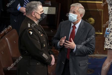 Sen. Lindsey Graham, R-S.C., talks with Chairman of the Joint Chiefs of Staff Gen. Mark Milley before President Joe Biden speaks to a joint session of Congress, in the House Chamber at the U.S. Capitol in Washington