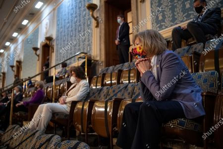 Stock Photo of UNITED STATES - April 28: United States Senator Tina Smith (Democrat of Minnesota), watches US President Joe Biden deliver his address to the joint session of Congress in the U.S. Capitol in Washington.