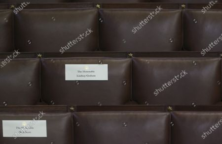 The first name of United States Senator Lindsey Graham (Republican of South Carolina) is misspelled on his seat place holder in the U.S. House Chamber before President Joe Biden's first address to a joint session of the U.S. Congress at the U.S. Capitol in Washington, U.S.,.