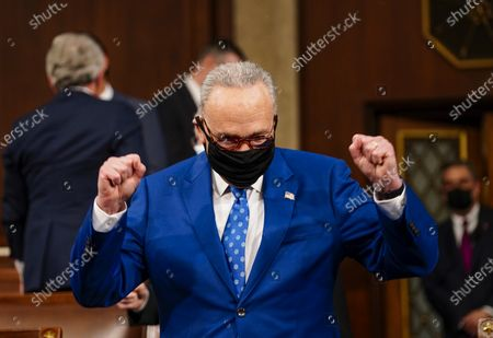 WASHINGTON, DC - APRIL 28: Senate Majority Leader Charles E. Schumer (D-N.Y.) is pumped up before President Joe Biden addresses a joint session of Congress, with Vice President Kamala Harris and House Speaker Nancy Pelosi (D-Calif.) on the dais behind him,. Biden spoke to a nation seeking to emerge from twin crises of pandemic and economic slide in his first speech to a joint session of Congress. (Melina Mara/The Washington Post)