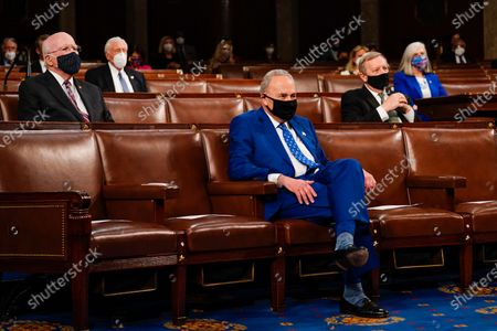 WASHINGTON, DC - APRIL 28: Senate Majority Leader Charles E. Schumer (D-N.Y.) watches as President Joe Biden addresses a joint session of Congress, with Vice President Kamala Harris and House Speaker Nancy Pelosi (D-Calif.) on the dais behind him,. Biden spoke to a nation seeking to emerge from twin crises of pandemic and economic slide in his first speech to a joint session of Congress. (Photo by Melina Mara/The Washington Post/POOL)