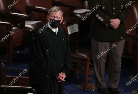 Stock Image of Chief Justice of the United States John G. Roberts, Jr. arrives before US President Joe Biden arrives to deliver his first address to a joint session of Congress in the House chamber of the US Capitol in Washington, DC, USA, 28.