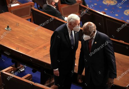 WASHINGTON, DC - APRIL 28: Rep. Jim Clyburn (D-SC) (R) talks to Rep. Steny Hoyer (D-MD) (R) before U.S. President Joe Biden addresses a joint session of congress in the House chamber of the U.S. Capitol in Washington, DC. On the eve of his 100th day in office, Biden spoke about his plan to revive America's economy and health as it continues to recover from a devastating pandemic. He delivered his speech before 200 invited lawmakers and other government officials instead of the normal 1600 guests because of the ongoing COVID-19 pandemic. (Photo by Chip Somodevilla/Getty Images)