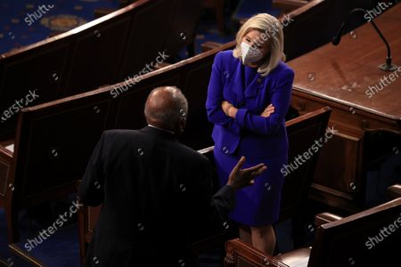 WASHINGTON, DC - APRIL 28: Rep. Jim Clyburn (D-SC) (L) talks to Rep. Liz Cheney (R-WY) (R) before U.S. President Joe Biden addresses a joint session of congress in the House chamber of the U.S. Capitol in Washington, DC. On the eve of his 100th day in office, Biden spoke about his plan to revive America's economy and health as it continues to recover from a devastating pandemic. He delivered his speech before 200 invited lawmakers and other government officials instead of the normal 1600 guests because of the ongoing COVID-19 pandemic. (Photo by Chip Somodevilla/Getty Images)