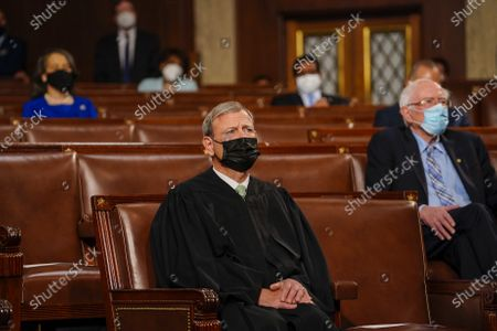Chief Justice John G Roberts Jnr. listens as President Biden delivers his first joint address to a session of Congress at the U.S. Capitol in Washington DC, on Wednesday, April 28, 2021. Pool photo by Melina Mara/UPI