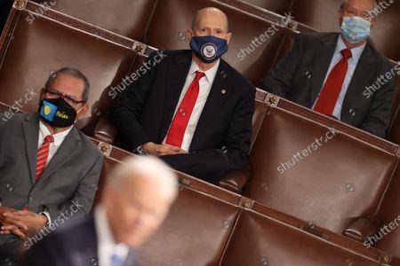 Stock Image of U.S. Senator Rick Scott (R-FL) and Senator Lindsey Graham (R-SC) listen as U.S. President Joe Biden addresses a joint session of Congress at the Capitol in Washington, DC, USA, 28 April 2021. The speech was Biden's first since taking office in January.