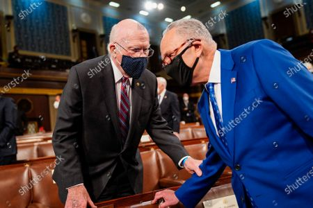 Stock Picture of Senate Majority Leader Charles E. Schumer (D-N.Y.), right, talks with Sen. Patrick J. Leahy (D-Vt.) before President Joe Biden addresses a joint session of Congress, at the Capitol in Washington, DC, USA, 28 April 2021. The speech was Biden's first since taking office in January.