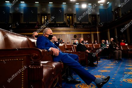 Senate Majority Leader Charles E. Schumer (D-N.Y.) listens as President Joe Biden addresses a joint session of Congress, at the Capitol in Washington, DC, USA, 28 April 2021. The speech was Biden's first since taking office in January.