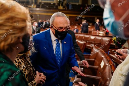Stock Photo of Senate Majority Leader Charles E. Schumer (D-N.Y.) talks with other lawmakers after President Joe Biden addressed a joint session of Congress, at the Capitol in Washington, DC, USA, 28 April 2021. The speech was Biden's first since taking office in January.