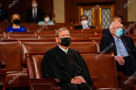 Stock Photo of Chief Justice John G. Roberts Jr. listens as President Joe Biden addresses a joint session of Congress, at the Capitol in Washington, DC, USA, 28 April 2021. The speech was Biden's first since taking office in January.