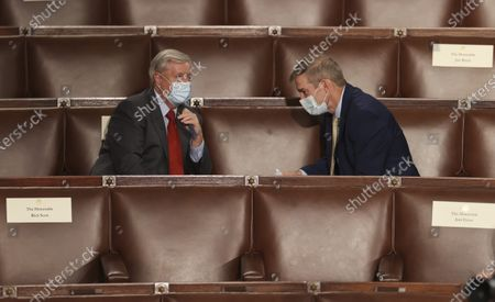 Stock Picture of U.S. Senator Lindsey Graham (R-SC) sits and talks with U.S. Rep. Jim Jordan (R-OH) as they await U.S. President Joe Biden's first address to a socially distant joint session of the U.S. Congress at the Capitol in Washington, DC, USA, 28 April 2021. The speech was Biden's first since taking office in January.