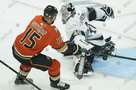 Los Angeles Kings goaltender Calvin Petersen (40) blocks a shot by Anaheim Ducks center Ryan Getzlaf (15) during the first period of an NHL hockey game, in Los Angeles