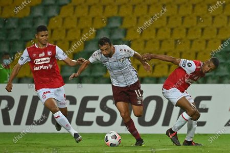 Stock Picture of Jorge Ramos (L) of Santa Fe vies for the ball with Anderson de Carvalho of Fluminense during the Copa Libertadores soccer match between Santa Fe y Fluminense at Centenario stadium in Armenia Colombia, 28 April 2021.