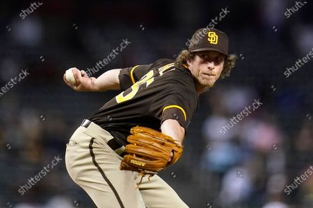 San Diego Padres relief pitcher Tim Hill throws a pitch against the Arizona Diamondbacks during the sixth inning of a baseball game, in Phoenix