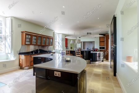Kitchen.   A grand Georgian manor where writer Evelyn Waugh lived and died is on the market for £5.5m.  The author of Vile Bodies, Brideshead Revisited and Sword of Honour bought Combe Florey House in Somerset in 1956 and his family lived there until 2008 when they sold it to the current owners.  In Waugh's day the house was often filled with his glamorous and clever guests like poet John Betjeman, actors Peter Cook and Alec Guinness and writers Salman Rushdie and Muriel Spark.  The 12-bedroom house has had a makeover since Waugh's day and quirky style and is now a light-filled spacious family home with a party barn, swimming pool and 34 acres.