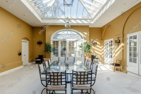 Orangery.   A grand Georgian manor where writer Evelyn Waugh lived and died is on the market for £5.5m.  The author of Vile Bodies, Brideshead Revisited and Sword of Honour bought Combe Florey House in Somerset in 1956 and his family lived there until 2008 when they sold it to the current owners.  In Waugh's day the house was often filled with his glamorous and clever guests like poet John Betjeman, actors Peter Cook and Alec Guinness and writers Salman Rushdie and Muriel Spark.  The 12-bedroom house has had a makeover since Waugh's day and quirky style and is now a light-filled spacious family home with a party barn, swimming pool and 34 acres.