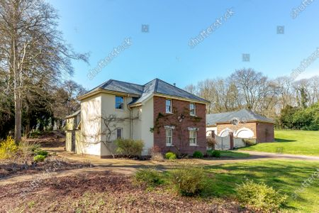 The three-bedroom cottage, workshops and a coachhouse.   A grand Georgian manor where writer Evelyn Waugh lived and died is on the market for £5.5m.  The author of Vile Bodies, Brideshead Revisited and Sword of Honour bought Combe Florey House in Somerset in 1956 and his family lived there until 2008 when they sold it to the current owners.  In Waugh's day the house was often filled with his glamorous and clever guests like poet John Betjeman, actors Peter Cook and Alec Guinness and writers Salman Rushdie and Muriel Spark.  The 12-bedroom house has had a makeover since Waugh's day and quirky style and is now a light-filled spacious family home with a party barn, swimming pool and 34 acres.