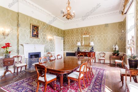 Dining room.   A grand Georgian manor where writer Evelyn Waugh lived and died is on the market for £5.5m.  The author of Vile Bodies, Brideshead Revisited and Sword of Honour bought Combe Florey House in Somerset in 1956 and his family lived there until 2008 when they sold it to the current owners.  In Waugh's day the house was often filled with his glamorous and clever guests like poet John Betjeman, actors Peter Cook and Alec Guinness and writers Salman Rushdie and Muriel Spark.  The 12-bedroom house has had a makeover since Waugh's day and quirky style and is now a light-filled spacious family home with a party barn, swimming pool and 34 acres.