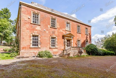 Stock Picture of Combe Florey House.   A grand Georgian manor where writer Evelyn Waugh lived and died is on the market for £5.5m.  The author of Vile Bodies, Brideshead Revisited and Sword of Honour bought Combe Florey House in Somerset in 1956 and his family lived there until 2008 when they sold it to the current owners.  In Waugh's day the house was often filled with his glamorous and clever guests like poet John Betjeman, actors Peter Cook and Alec Guinness and writers Salman Rushdie and Muriel Spark.  The 12-bedroom house has had a makeover since Waugh's day and quirky style and is now a light-filled spacious family home with a party barn, swimming pool and 34 acres.
