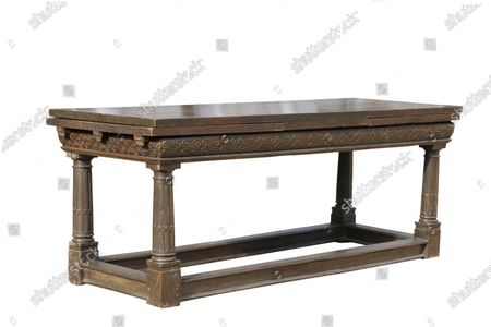 An Elizebeth I Oak refectory table sold for £49400    The contents of a millionaire financier's stately home have sold for over £750,000.  Dewlish House in Dorset, one of the most beautiful stately homes in Britain, sold recently for only the second time in its 300-year history and its treasures have gone under the hammer.  The top selling lot was a spectacular Queen Anne gilt mirror similar to one in the V&A Museum which sold for £65,000 including fees.  A George II giltwood console table, designed in the manner of William Kent, also went for double its estimate at £40,000 hammer, £52,000 including fees.  A pair of George III Serpentine chest of drawers sold for £39,000 and a rare oak bed dating from the reign of King Henry VIII sold for £26,000.