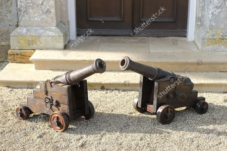 A pair of late 19th century cannons, with cast iron stepped barrels, on oak carriages sold for £5850  The contents of a millionaire financier's stately home have sold for over £750,000.  Dewlish House in Dorset, one of the most beautiful stately homes in Britain, sold recently for only the second time in its 300-year history and its treasures have gone under the hammer.  The top selling lot was a spectacular Queen Anne gilt mirror similar to one in the V&A Museum which sold for £65,000 including fees.  A George II giltwood console table, designed in the manner of William Kent, also went for double its estimate at £40,000 hammer, £52,000 including fees.  A pair of George III Serpentine chest of drawers sold for £39,000 and a rare oak bed dating from the reign of King Henry VIII sold for £26,000.