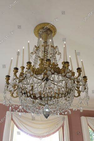 An important Empire Chandelier with cut-prismatic drops, sold for £9100  The contents of a millionaire financier's stately home have sold for over £750,000.  Dewlish House in Dorset, one of the most beautiful stately homes in Britain, sold recently for only the second time in its 300-year history and its treasures have gone under the hammer.  The top selling lot was a spectacular Queen Anne gilt mirror similar to one in the V&A Museum which sold for £65,000 including fees.  A George II giltwood console table, designed in the manner of William Kent, also went for double its estimate at £40,000 hammer, £52,000 including fees.  A pair of George III Serpentine chest of drawers sold for £39,000 and a rare oak bed dating from the reign of King Henry VIII sold for £26,000.