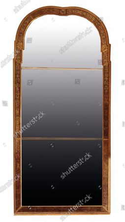 The top selling lot was a spectacular Queen Anne gilt mirror similar to one in the V&A Museum which sold for £65,000 including fees.  The contents of a millionaire financier's stately home have sold for over £750,000.  Dewlish House in Dorset, one of the most beautiful stately homes in Britain, sold recently for only the second time in its 300-year history and its treasures have gone under the hammer.  The top selling lot was a spectacular Queen Anne gilt mirror similar to one in the V&A Museum which sold for £65,000 including fees.  A George II giltwood console table, designed in the manner of William Kent, also went for double its estimate at £40,000 hammer, £52,000 including fees.  A pair of George III Serpentine chest of drawers sold for £39,000 and a rare oak bed dating from the reign of King Henry VIII sold for £26,000.