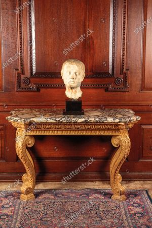 A George II table sold for £52,000  The contents of a millionaire financier's stately home have sold for over £750,000.  Dewlish House in Dorset, one of the most beautiful stately homes in Britain, sold recently for only the second time in its 300-year history and its treasures have gone under the hammer.  The top selling lot was a spectacular Queen Anne gilt mirror similar to one in the V&A Museum which sold for £65,000 including fees.  A George II giltwood console table, designed in the manner of William Kent, also went for double its estimate at £40,000 hammer, £52,000 including fees.  A pair of George III Serpentine chest of drawers sold for £39,000 and a rare oak bed dating from the reign of King Henry VIII sold for £26,000.