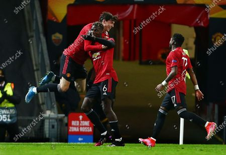 Paul Pogba of Manchester United celebrates scoring a goal to make it 5-2 with Victor Lindelof