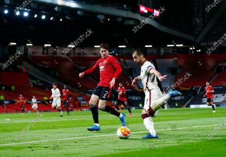 Stock Image of Henrikh Mkhitaryan of Roma and Victor Lindelof of Manchester United