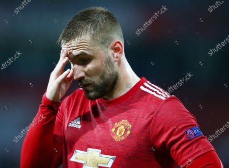 Luke Shaw of Manchester United looks dejected