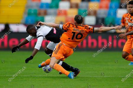 Leonardo Bonucci of Juventus tackles Udinese's Stefano Okaka.