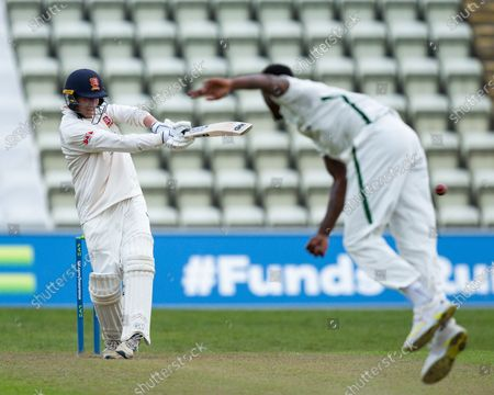 Stock Photo of Dan Lawrence of Essex pulls a ball from Alzarri Joseph of Worcestershire