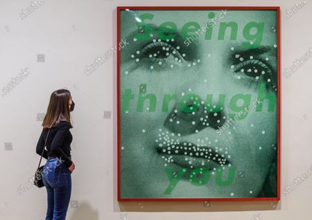 Stock Photo of A visitor looks at the artwork 'Seeing through you', by US artist Barbara Kruger, during the presentation of the exhibition 'Womanology. Collection of Jose Ramon Prieto' at Fine Arts Museum in Bilbao, Basque Country, northern Spain, 29 April 2021. The exhibition exhibits Jose Ramon Prieto's collection, exclusively made up of artworks by female contemporary artists.