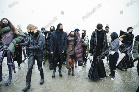 Stock Image of Rick Owens and Michele Lamy with the models in the backstage of his own Fashion show in Venezia Lido, Fall Winter 2021, Ready To Wear Fashion Week