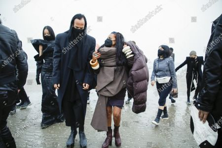 Rick Owens and Michele Lamy with the models in the backstage of his own Fashion show in Venezia Lido, Fall Winter 2021, Ready To Wear Fashion Week