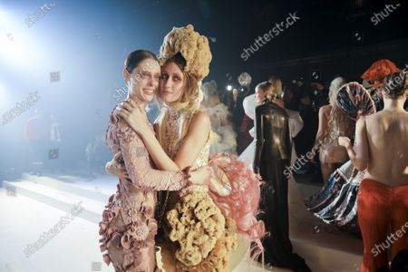 Coco Rocha and Anna Cleveland at the Jean Paul Gaultier Fashion show in Paris, Spring Summer 2020, Couture Fashion Week