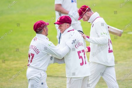 Northamptonshire's Ben Curran is congratulated on taking a catch to dismiss Yorkshire's Gary Ballance.