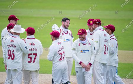 Northamptonshire's Wayner Parnell is congratulated on taking the wicket of Yorkshire's Gary Ballance.