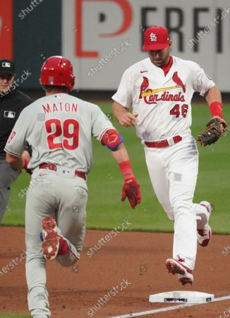 St. Louis Cardinals first baseman Paul Goldschmidt beats Philadelphia Phillies Nick Mason to first base for the out in the second inning at Busch Stadium in St. Louis on Wednesday, April 28, 2021.