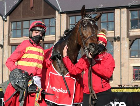 Stock Photo of The Ladbrokes Champion Stayers Hurdle. Patrick Mullins with Klassical Dream and Eilish Byrne after winning