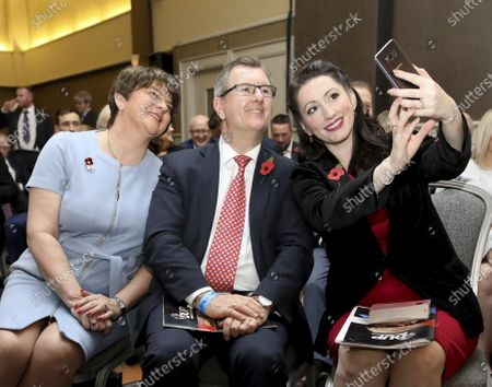 Democratic Unionist Party leader Arlene Foster, left, has her picture taken with party members Jeffrey Donaldson, MP, and Emma Littele-Pengelly, MP, at the party's annual conference in Belfast, Northern Ireland. Northern Ireland's Democratic Unionist Party is looking for a new leader following the announcement by First Minister Arlene Foster that she will be standing down after nearly five and a half years in post. Following weeks of pressure related to her handling of Brexit and her perceived softening on social issues such as abortion and LGBT rights, Foster said she would step down as leader of the party on May 28 and as first minister at the end of June. Potential candidates include Jeffrey Donaldson, Edwin Poots, Gavin Robinson, Sammy Wilson and Ian Paisley Jr