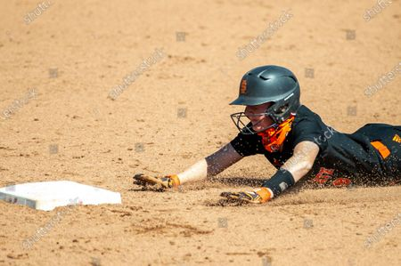 Stock Picture of Idaho St. catcher Morgan Hess (9) slides into second base during an NCAA softball game on in Salt Lake City