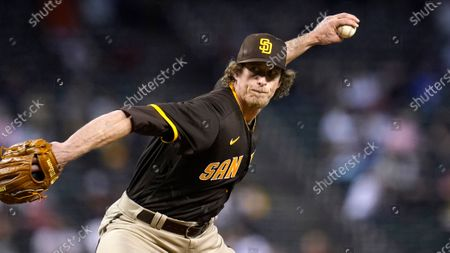Stock Picture of San Diego Padres relief pitcher Tim Hill throws a pitch against the Arizona Diamondbacks during the sixth inning of a baseball game, in Phoenix