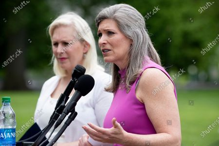 Stock Picture of Republican Senator from Iowa Joni Ernst (Front) speaks during a news conference on the 'Military Justice Improvement and Increasing Prevention Act', beside Democratic Senator from New York Kirsten Gillibrand (Back), on Capitol Hill in Washington, DC, USA, 29 April 2021. The legislation, which has bipartisan support, aims to move the decision to prosecute serious crimes in the military, such as sexual assault, away from the chain of command to professional military prosecutors.