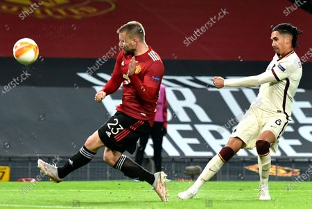Chris Smalling (R) of Roma in action against Luke Shaw (L) of Manchester United during the UEFA Europa League semi final, first leg soccer match between Manchester United and AS Roma at Old Trafford in Manchester, Britain, 29 April 2021.