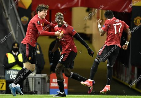 Paul Pogba (C) of Manchester United celebrates with teammates Victor Lindelof (L) and Fred (R) after scoring the 5-2 lead during the UEFA Europa League semi final, first leg soccer match between Manchester United and AS Roma at Old Trafford in Manchester, Britain, 29 April 2021.