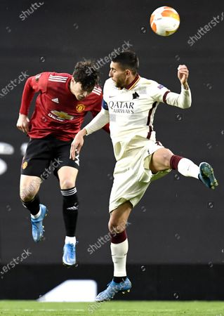 Victor Lindelof (L) of Manchester United in action against Lorenzo Pellegrini (R) of Roma during the UEFA Europa League semi final, first leg soccer match between Manchester United and AS Roma at Old Trafford in Manchester, Britain, 29 April 2021.